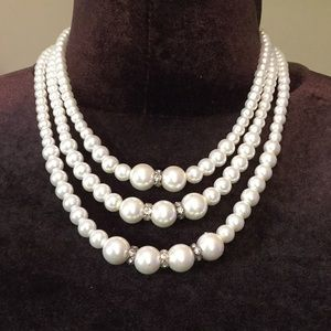 3 strand pearl necklace with matching earrings